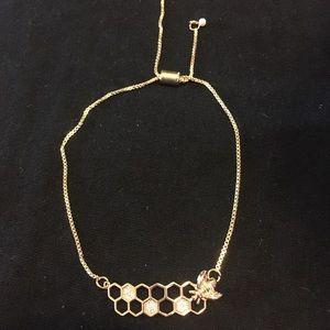 Adjustable bee & honeycomb gold colored bracelet